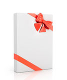 The white box wrapped with red ribbon with a bow Royalty Free Stock Photos