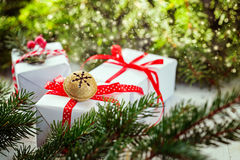 White boxes decorated red ribbon and Metal Jingle Bell. Christmas Holiday Decoration Royalty Free Stock Photo