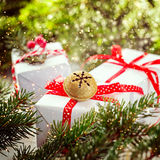 White boxes decorated red ribbon and Metal Jingle Bell. Christmas Holiday Decoration Royalty Free Stock Photos