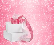 White boxes with gifts with pink ribbons Royalty Free Stock Photography