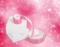 White boxes with gifts with pink ribbons Royalty Free Stock Photos