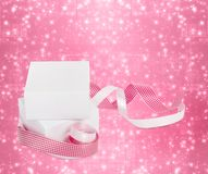 White boxes with gifts with pink ribbons Royalty Free Stock Photo