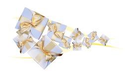 White boxes with gold bow Stock Photos