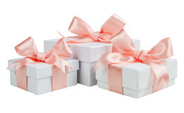 White boxes with pink ribbons isolated on white background Royalty Free Stock Photo
