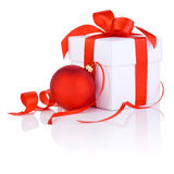 White boxs with a red ribbon and christmas ball Royalty Free Stock Photos