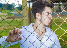 White boy behind fence ` Stock Photography