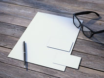 White branding mockup with black glasses Royalty Free Stock Images