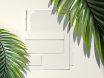 White branding mockup and palm leafs. 3d rendering. White branding mockup and palm leafs. Summer vacation concept. 3d rendering Royalty Free Stock Photography