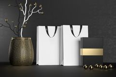White branding paper shopping bag with handles and luxury black box Mock Up. Premium white package for purchases mockup. On a black background. 3d rendering royalty free stock photo