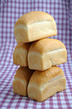 White bread. A few loaves of white bread on tablecloth Stock Images