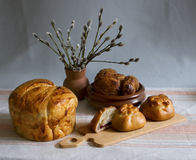 White bread. Still-life with bread, gingerbreads and a bouquet of a willow Stock Photography