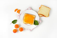 White bread with apricot jam Stock Images