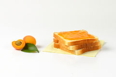 White bread with apricot jam Royalty Free Stock Photography