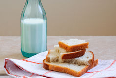 White bread and a bottle of milk Stock Image