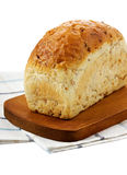 White bread with bran. On white Stock Images