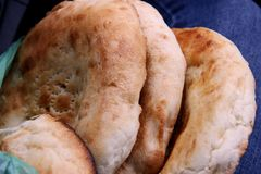 White bread buns from tandyr. Tandoor pita Asian cuisine. royalty free stock images