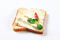 White bread with cheese spread Stock Image