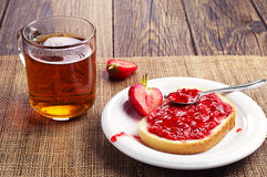 White bread with jam and cup of tea Stock Photos