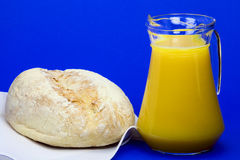 White bread and jug of juice Stock Images