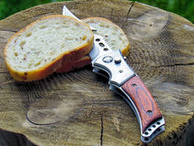 White bread. By knife outdoors Royalty Free Stock Photo