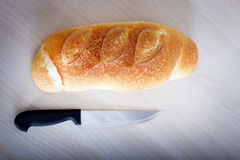 White bread with knife Royalty Free Stock Photo