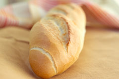 White bread loaf near the napkins Stock Images
