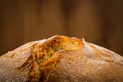 White bread over wooden background Stock Photography