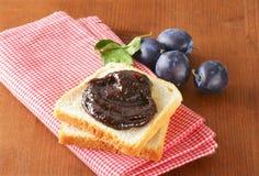 White bread with plum jam Stock Photos