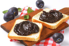 White bread with plum jam Stock Images