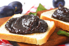 White bread with plum jam Stock Photos