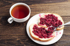 White bread with raspberry jam Stock Image