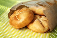White bread rolls. Three small buns made of white flour in paper bag Stock Images