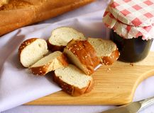White bread with sesame and glass of jam Stock Images