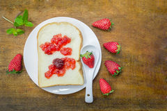 White bread slice with strawberry jam Stock Photography
