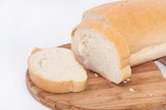 White bread sliced on a wooden board Stock Photography
