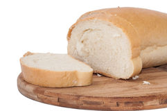 White bread sliced on a wooden board Royalty Free Stock Photography