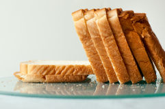White bread slices. On glass surface Royalty Free Stock Images