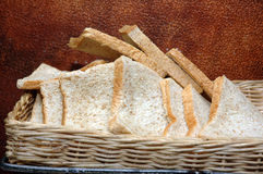 White bread. Slices of white bread in wicker basket Stock Photos