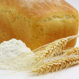White Bread And Spikes Of Wheat And Wheat Flour. On White Stock Photo