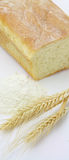 White Bread And Spikes Of Wheat And Wheat Flour. On White Royalty Free Stock Photography