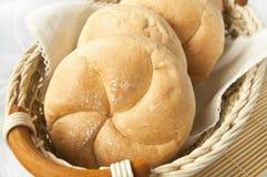 White breadrolls fresh and ready for breakfast. Basket full of white wheat breadrolls, freshly baked and ready for breakfast Royalty Free Stock Photography