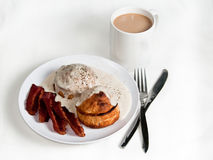White breakfast. Breakfast with biscuits and gravy with slices of bacon and a cup of coffee Royalty Free Stock Photography