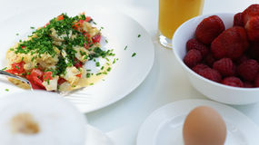 White Breakfast Dishes with Strawberries and Egg Stock Photography