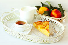 White breakfast with homemade peach pie, tea, milk and fresh fr Royalty Free Stock Photos