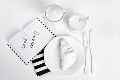 White breakfast. Minimal and notebook Stock Photography