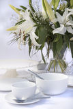 White breakfast table setting with lily flowers Royalty Free Stock Images