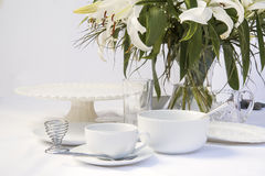 White breakfast table setting with lily flowers Stock Photography