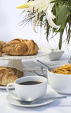 White breakfast table setting with lily flowers Stock Photo