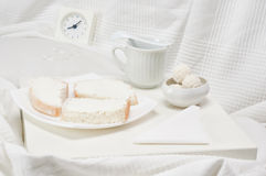 White breakfast. Tray with breakfast on a white bed royalty free stock photo
