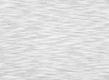 White breezy fabric texture. White breezy t-shirt cotton knitted fabric texture royalty free stock images